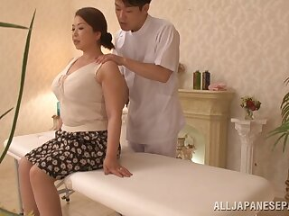 Fat Asian model Natsuko Kayama massaged coupled with fucked surpassing the table
